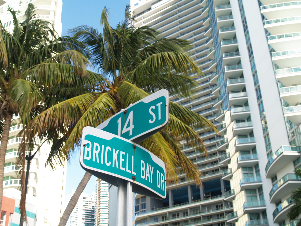 Street Sign of Brickell Avenue and 14th street with Brickell Condo building in distance