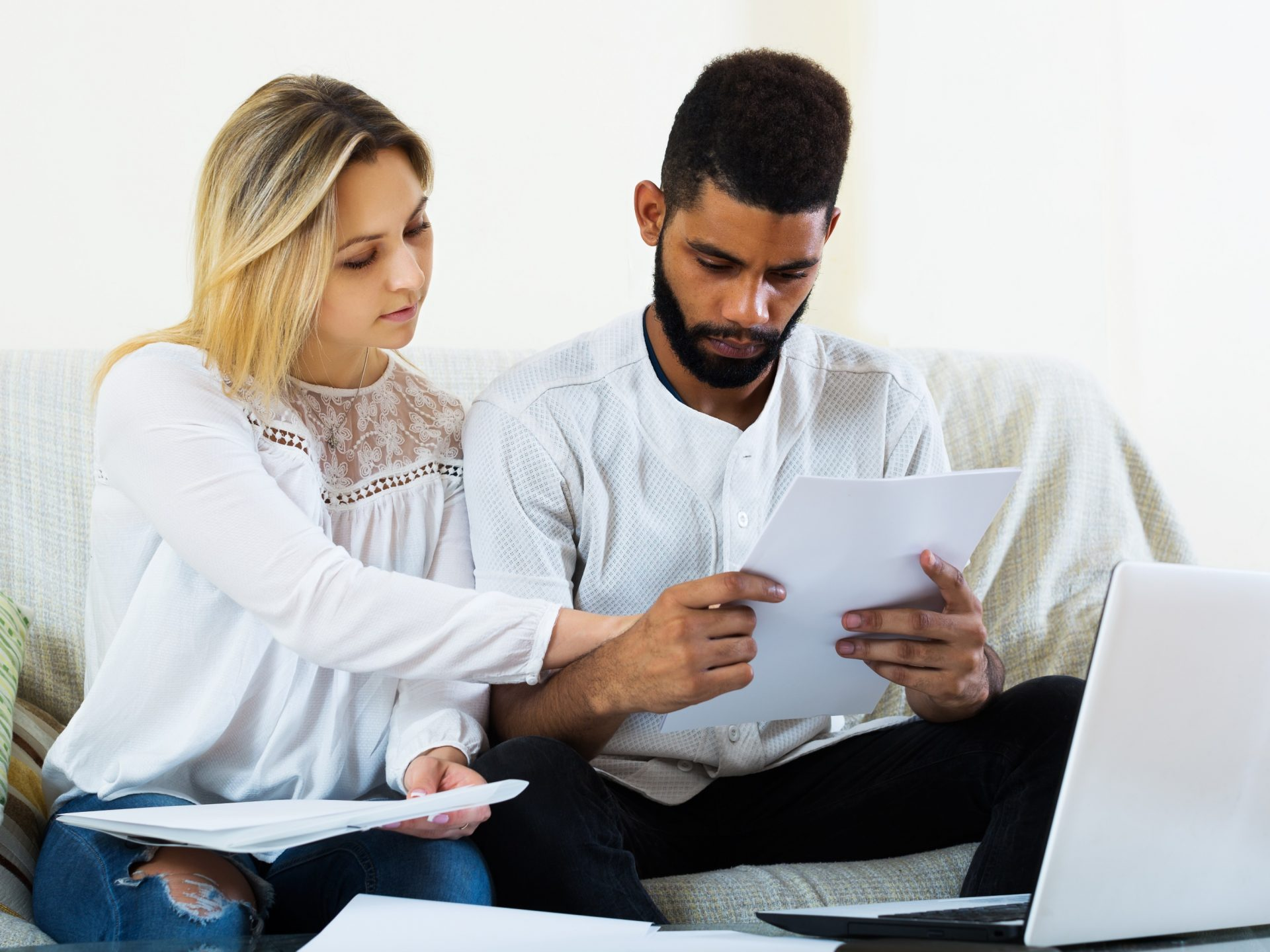 Young Couple filling papers for mortgage