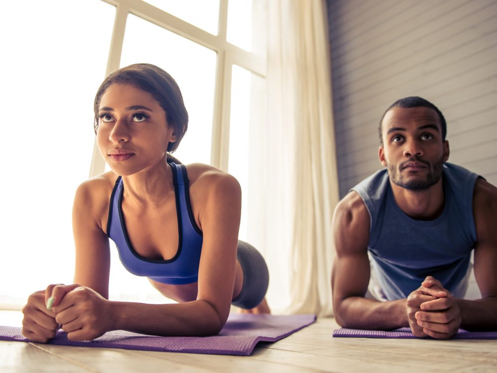 Couple doing Home exercise Fitness