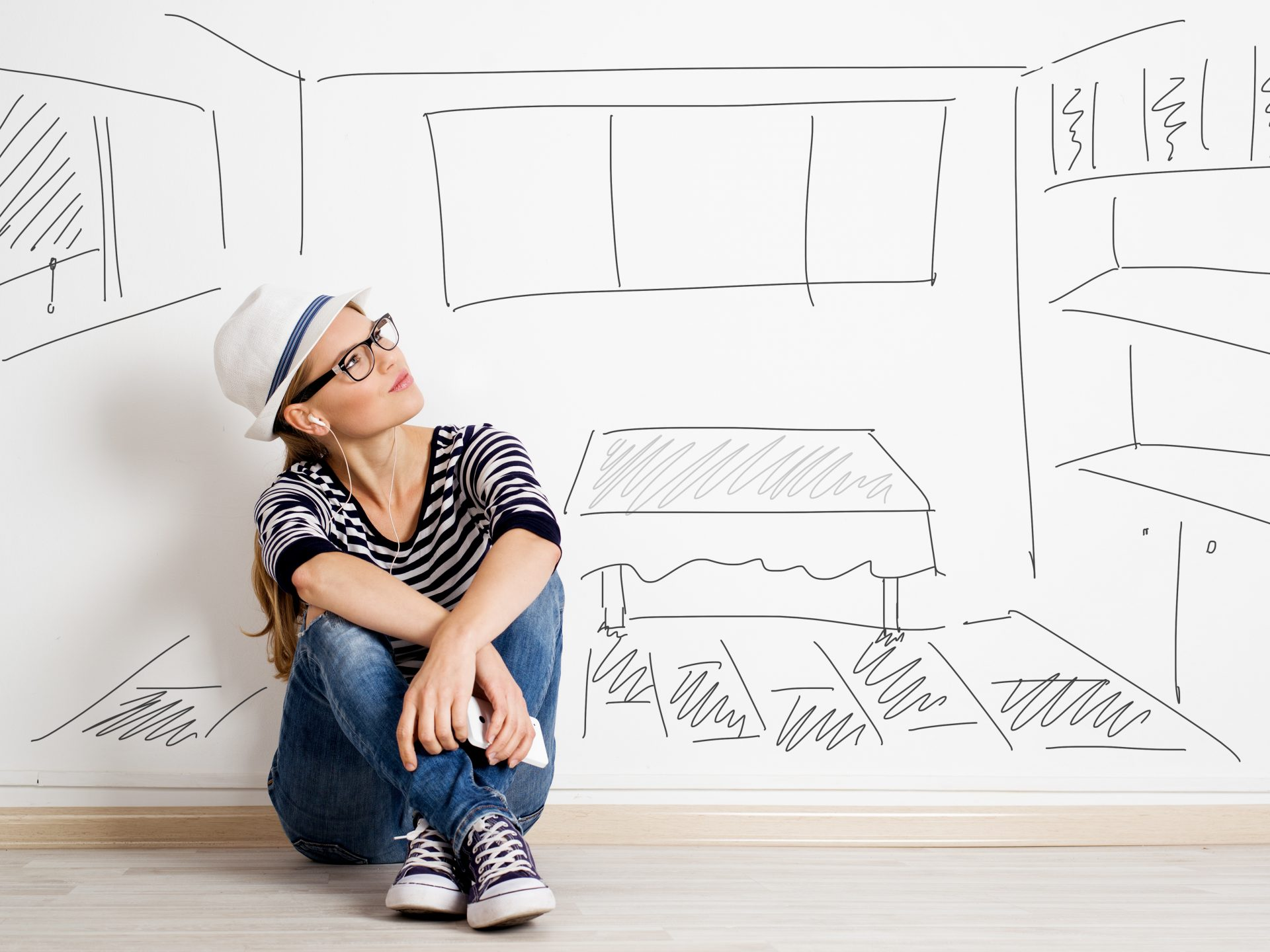Millennial home buyer looking at wall