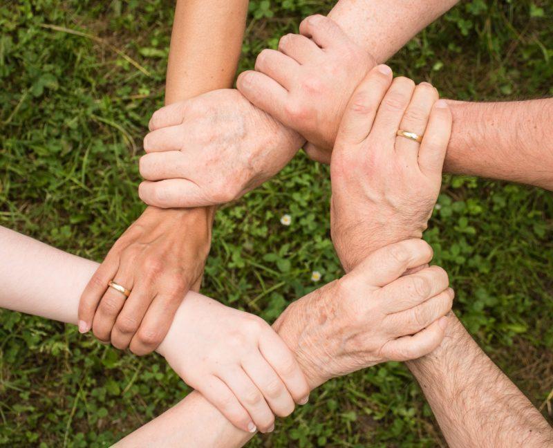 Neighbors Holding Arms courtesy of Pixa Bay